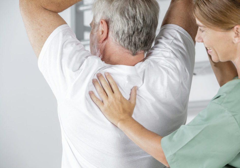 Elderly man in rehab with nurse
