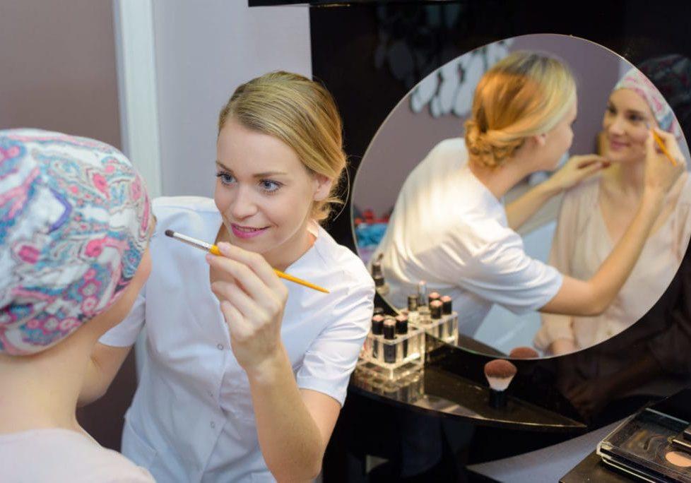 Beautician applying cosmetics