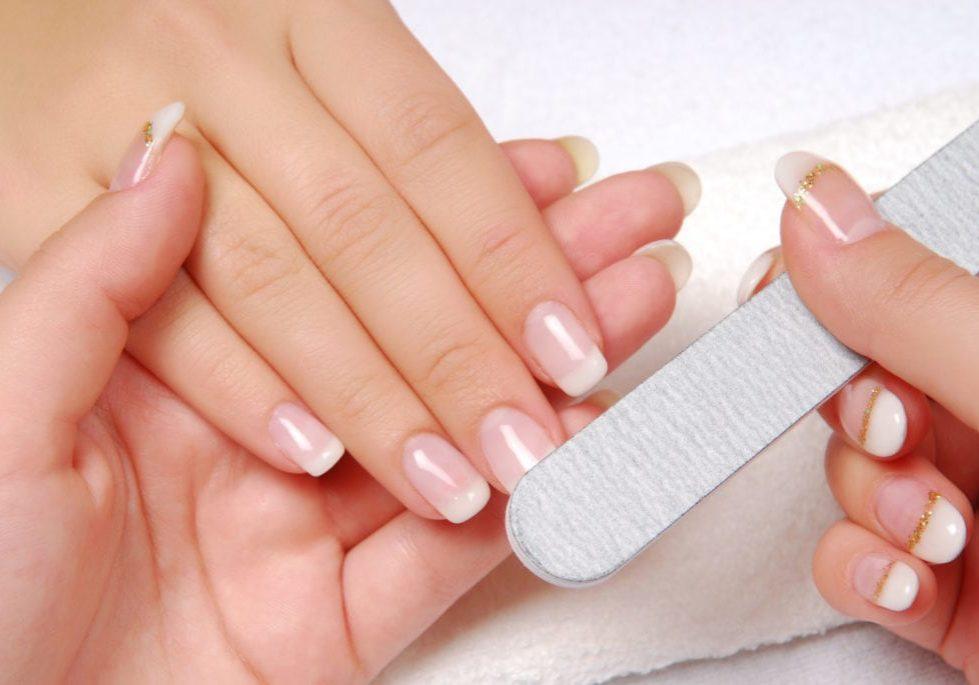 Studio nail — beautician polishing female nails